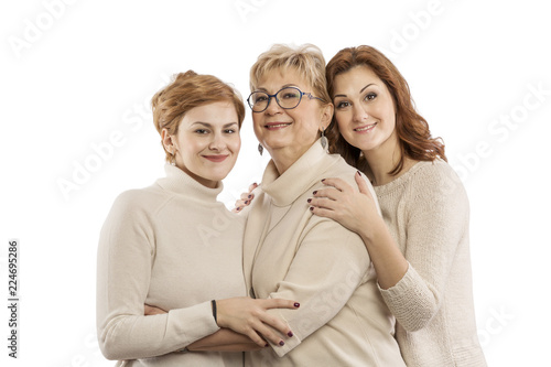 Mom with older daughter embracing and smiling, isolated on white background Wallpaper Mural
