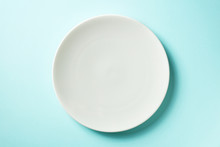 White Plate On Blue Background, From Above