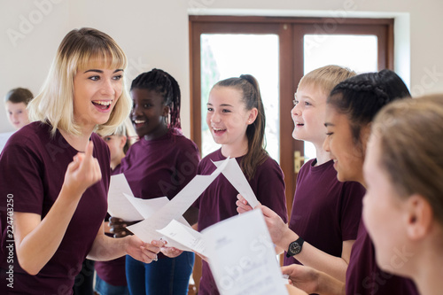 Photo Children In School Choir Being Encouraged By Teacher
