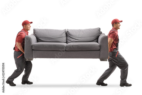 Obraz Movers carrying a couch - fototapety do salonu