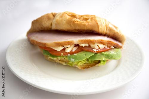 Foto op Aluminium Snack crossiant sandwich avocado, bacon, cheese, lettuce