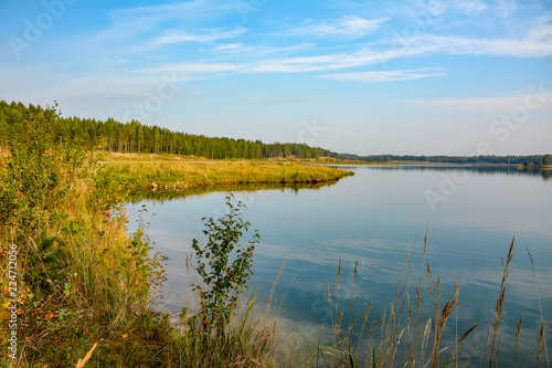 Artificial lake formed after the removal of sand. Closed sand quarry.