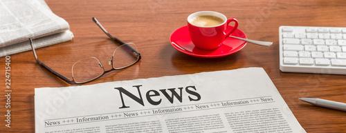 Obraz na płótnie A newspaper on a wooden desk - News