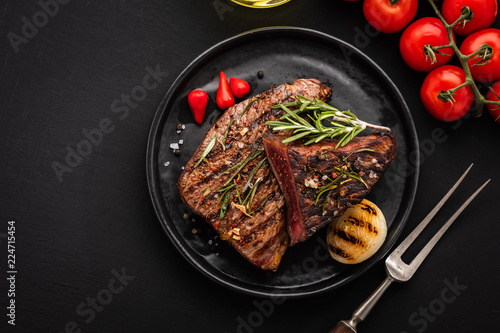 Fotobehang Steakhouse Delicious beef steak with salad, aromatic herbs, chery tomatoes