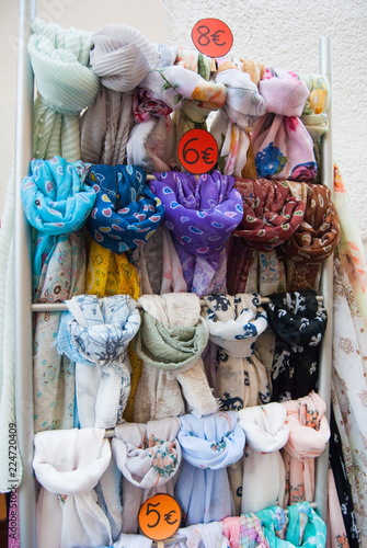 Many colorful headscarf hung as souvenirs Canvas Print