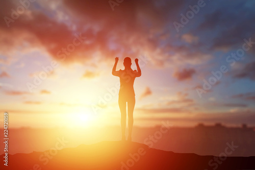 Fototapety, obrazy: Creative background, business silhouette, business girl on the background of a beautiful, golden sunset. The concept of inspiration, enthusiasm, start-up, feminism symphony.