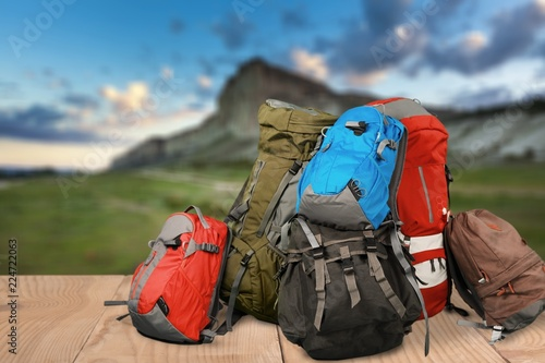 Photo Tourists backpacks for leisure activities on background