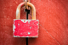 Rusty Pink Padlock Is On The Red Wall