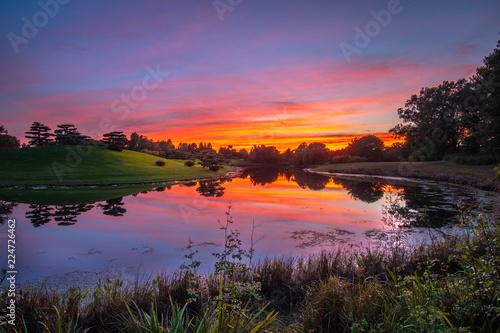 Foto op Aluminium Nachtblauw Sunset reflections at the lake