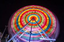 Fun-fair At Long Exposure. Light Trails Motion. Carousel Lights And Movements. Fun, Lifestile Concept.