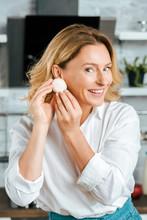 Beautiful Adult Woman Holding Mushroom Near Ear Like Earring And Looking At Camera