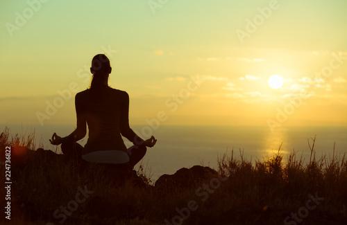 Fotobehang School de yoga Woman meditating outdoors. Personal reflection and meditation.