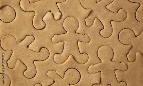 Raw Gingerbread Cookie Dough Being Cut into Gingerbread People