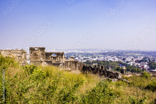 Ruins of a Fortress Wall with the Old City Skyline in the Background at Golconda Canvas Print
