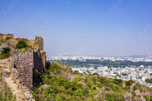 Photo  Ancient Stone Walls on the Hillside Looking out towards the Qutb Shahi Tombs at