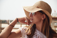 Beautiful Woman In Sunglasses And Straw Hat