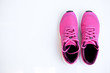 canvas print picture - pink running shoes for women on a white background