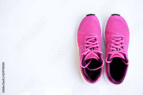 Fotografia pink running shoes for women on a white background