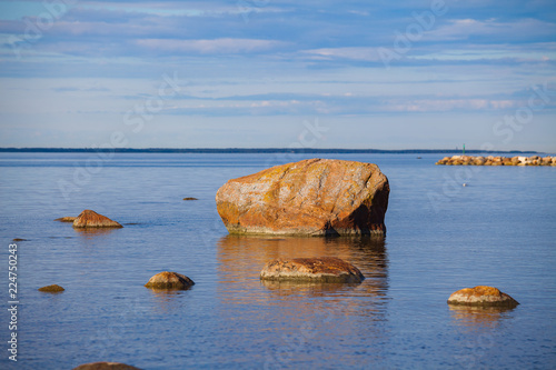 Tuinposter Kust Boulders at the coast of Baltic sea. Classic Estonian coastline views at sunny summer day.