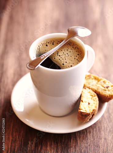 Photo Stands Coffee bar Cup of delicious coffee and cantuccinis. Brown wooden background.