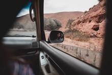 Mountains And Tree Through Car Window