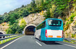 Leinwanddruck Bild - Coach, long haul bus, drives through a tunnel in northern Spain