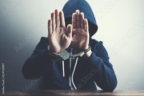 Fotografia  man handcuff with stop sign