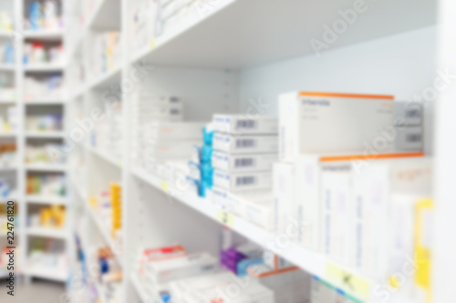 In de dag Apotheek Blurred medicine and healthcare product on shelves at pharmacy drugstore