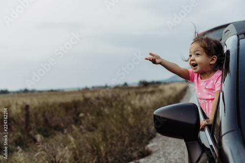 Fotografija Little Girl on Road Trip Full of Wonder and Exploration