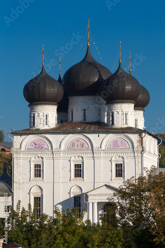 Deurstickers Bedehuis Cathedral on the river bank. Uspensky Trifonov Monastery, Kirov, Russia. Temple, Church, religion, domes.