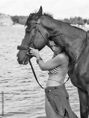 Keuken foto achterwand Akt horse and young beautiful naked Amazon woman on river shore