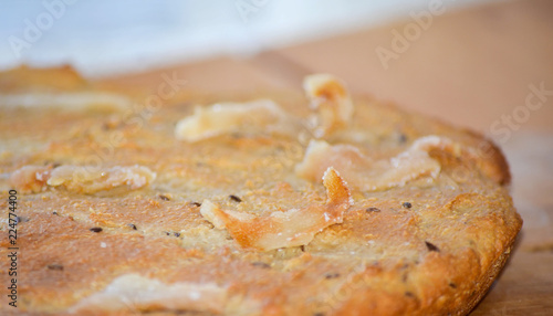 Flat bread with bacon and caraway seeds