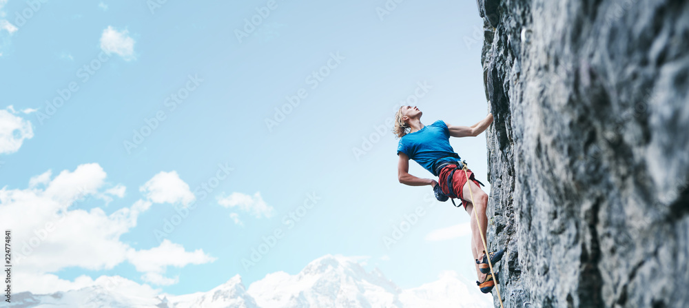 Fototapety, obrazy: rock climbing. man rock climber climbing the challenging route on the rocky wall