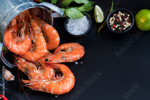 Perfect cooked prawns shrimps with herbs, spices text space