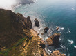 Beautiful aerial vibrant view of Capo Da Roca, the most western point of Europe, Portuguese municipality of Sintra, near Azoia, district of Lisbon, Serra de Sintra, Portugal, shot from drone