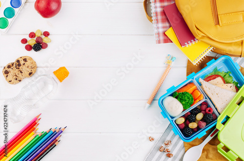 In de dag Assortiment Lunch box on white wooden background near school accessories and backpack.jpg