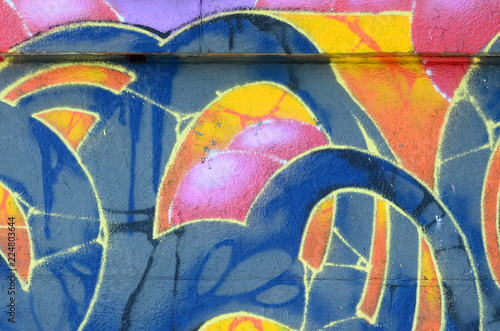 Fototapety, obrazy: Fragment of graffiti drawings. The old wall decorated with paint stains in the style of street art culture. Colored background texture in warm tones