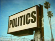 aged and worn politics sign with palm trees