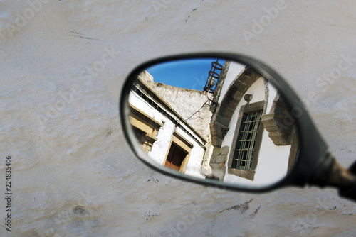 In de dag Noord Europa A reflection of a street from a scooter's side mirror in Patmos, Greece in summer