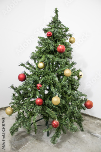 Detailed Green Christmas Tree With Red And Gold Decorations In A