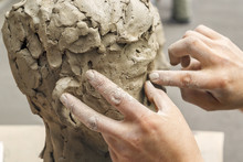 Sculptor Creates A Bust And Pu...