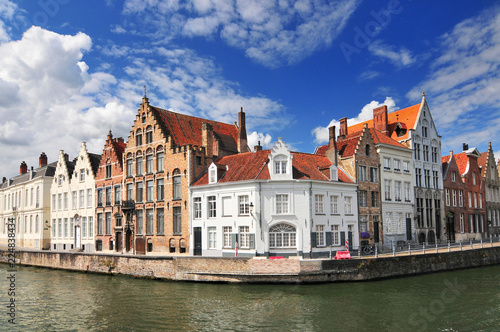 Canal and old houses in Bruges (Brugge) Belgium.