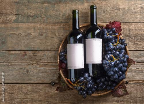 Fototapeta Grapes and bottles of red wine. obraz na płótnie