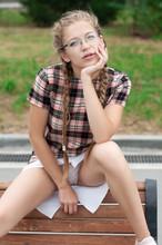 Nerd Girl In Short Dress In Provocative Pose