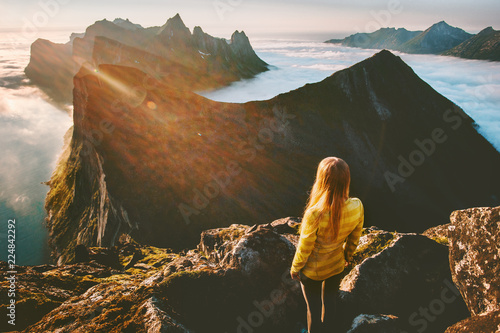 Tuinposter Grijze traf. Woman standing alone in sunset mountains hiking outdoor active vacations traveling adventure lifestyle enjoying breathtaking aerial view landscape