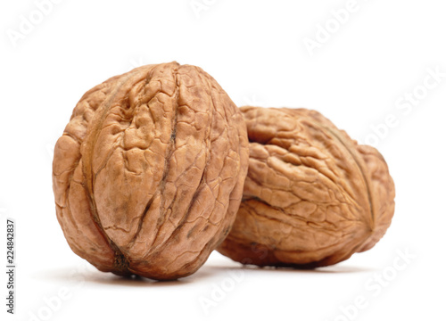Pair of organic walnuts isolated on white background