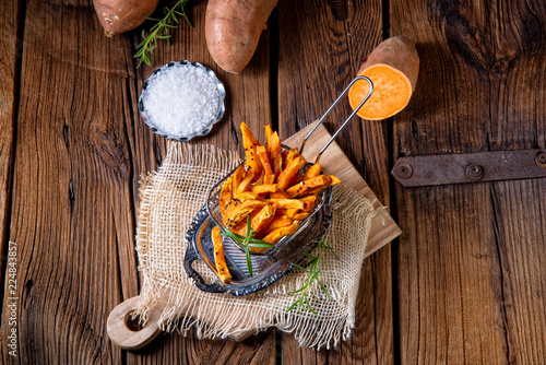 Leinwand Poster crispy sweet potato fries from the oven