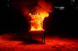 Wooden chair is on fire. Incineration of furniture. Conceptual photo, burnout