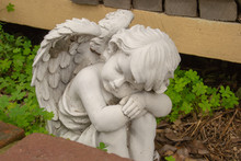 White Statue Of An Sleeping Angel