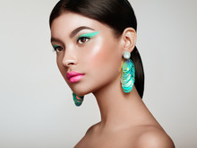 Beautiful Korean Woman With Large Turquoise Earrings. Perfect Makeup And Elegant Hairstyle. Turquoise Make-up Arrows And Pink Lipstick